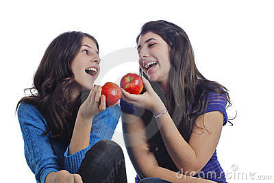 Two happy teenage girls with apples