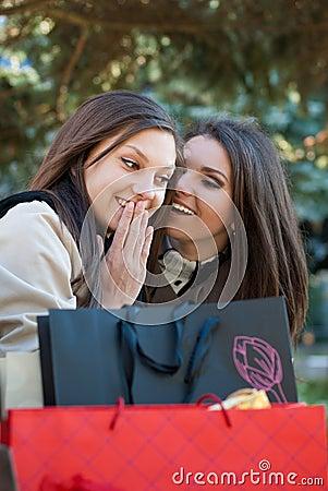 Two Happy Women - girls chatting on shopping trip