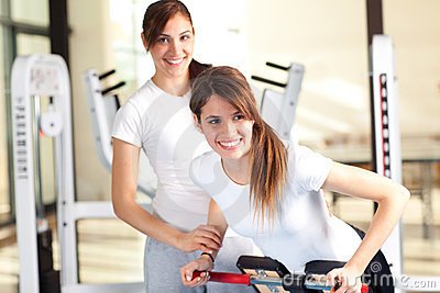 Two happy young women in the gym, selective focus