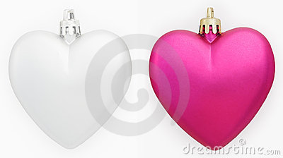 Two hearts Christmas decorations isolated on white