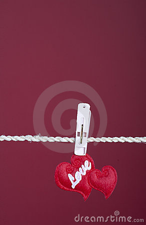 Two hearts hanging on a clotheline