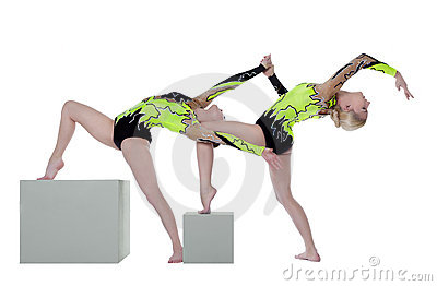 Two high skill woman as gymnast dance on cube
