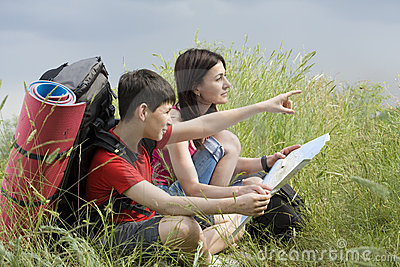 Two hikers with the map