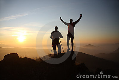 Two hikers on the mountain top