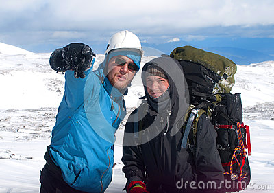 Two hikers in snow mountains
