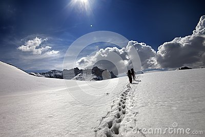 Two hikers on snow plateau