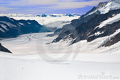 Two Hikers Walking Towards the Aletsch Glacier
