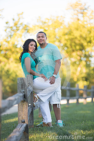Two Hispanic Couple Engagement Picture Walking