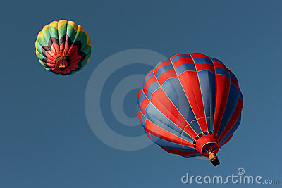 Two hot air balloons from below