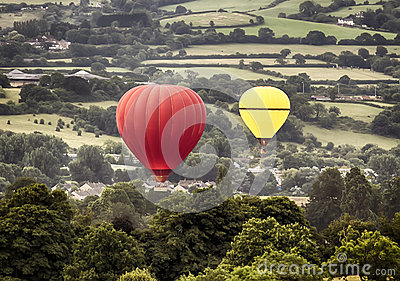 Two hot air baloons drifting