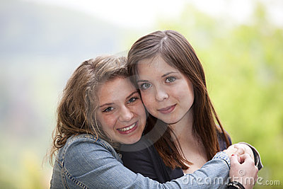 Two hugging teenage girls
