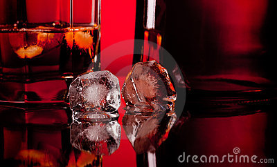 Two ice cube and whiskey
