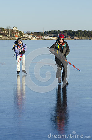 Two ice skaters on smoth ice
