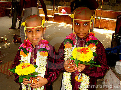 Two Indian boys in ceremony