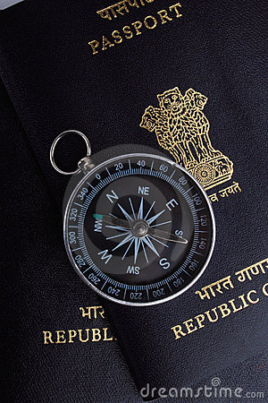 Two indian passports, a magnetic compass
