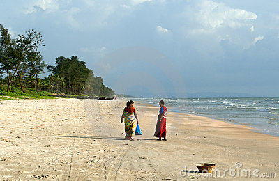 Two indian women in bright sari on the Goa beach Editorial Photo