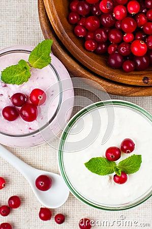 Two jars of berry dessert cream