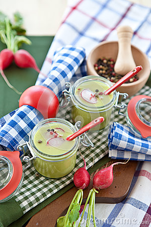 Two jars with warm pea soup