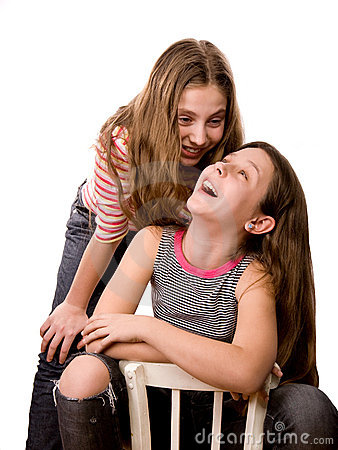 Two joyful teenagers girls isolated on white
