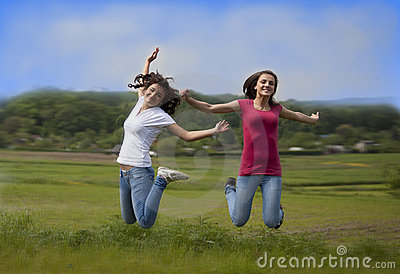 Two jumping girls