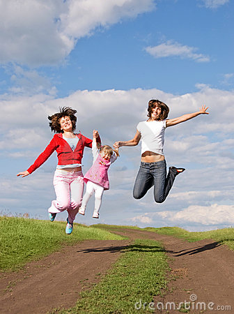 Two jumping women and one little girl