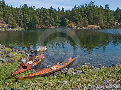 Two kayaks on rocky shore