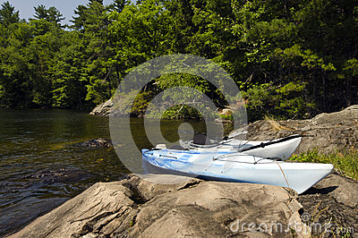 Kayaks on the Rocky Shoreline