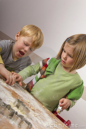 Free Two Kids Cutting Cookies For Christmas Stock Photo - 22158430