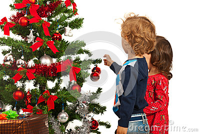 Two kids decorate Christmas tree