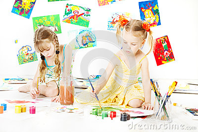 Two kids drawing with color brush. creative childdren