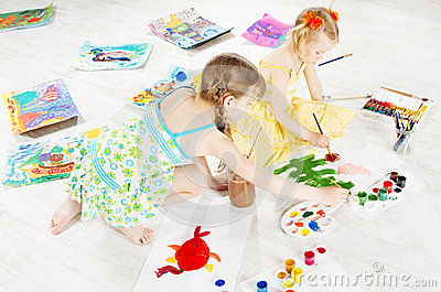 Two kids drawing with color brush