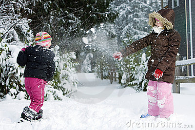Two kids having a snowball fight