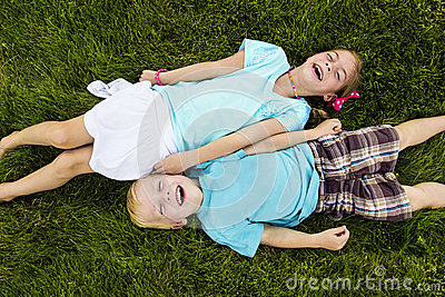 Two kids Laughing and having fun outdoors