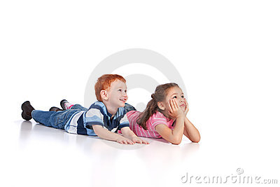 Two kids lying on floor