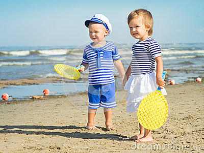 Image result for kids playing racket on the beach
