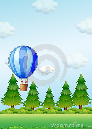 Two kids riding in an air balloon