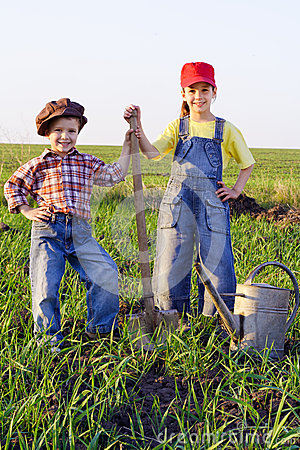 Two kids with shovel and can