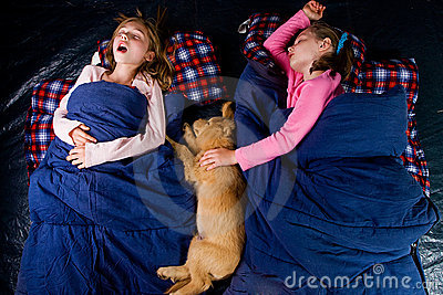 Two kids sound asleep in a tent