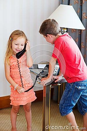 Two kids talking on phone