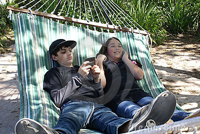 Two Kids Texting and Talking on Phone