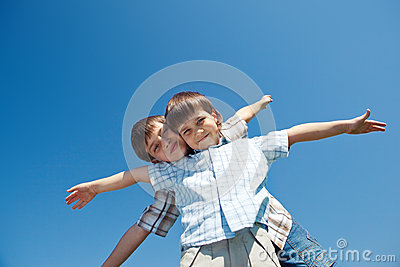 Two kids with their arms open wide
