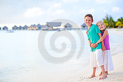 Two kids at tropical resort beach