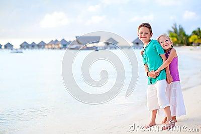Two kids at tropical resort beach