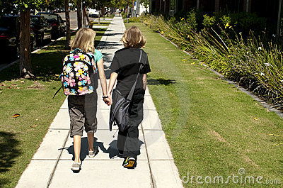 Two Kids Walking to School