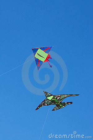 Two kites against a blue sky