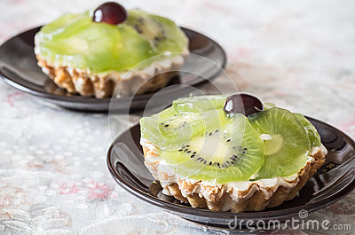 Two Kiwi fruit tarts