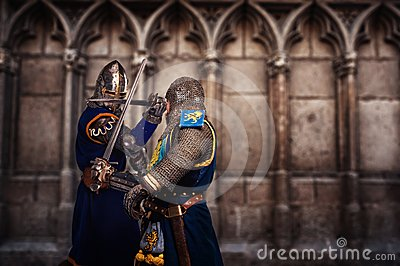 Two knights fighting agaist medieval cathedral