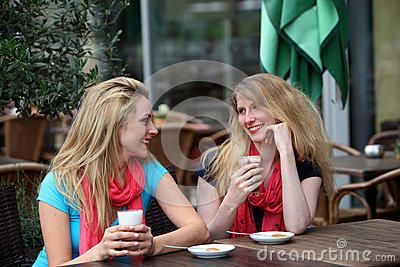 Two ladies chatting over refreshments