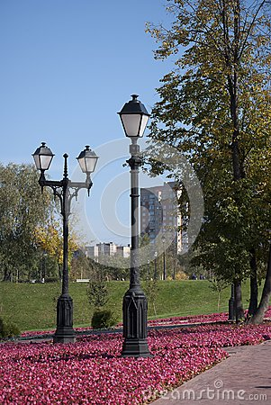 Two lamps in the autumn park.