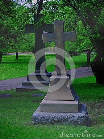 Two large crosses in a cemetery, with fog
